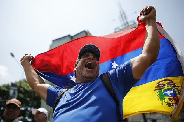 a-demonstrator-in-caracas-joins-another-day-of-protests-thursday-against-venezuelan-president-nicolas-maduro-whose-government-seized-a-general-motors-plant-wednesday