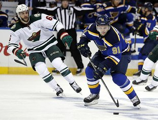 The Associated Press SIMPLY WILD: Vladimir Tarasenko brings the puck down the ice for St. Louis against Minnesota defender Marco Scandella, left, in Game 4 of their NHL first-round playoff series Wednesday night. Averting elimination with a 2-0 victory, the Minnesota Wild return home for Game 5 Saturday against the Blues.