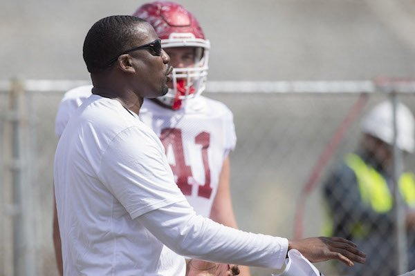 Assistant John Scott Jr., coaches during Arkansas' football practice on Saturday, April 8, 2017, at Donald W. Reynolds Razorback Stadium in Fayetteville.