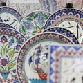 Handpainted dishes decorated by Jasim Morad of Houston (Perry County) are carefully arranged for dis...