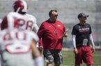 Coach Bret Bielema and assistant Barry Lunney Jr. look on during Arkansas football practice on Saturday, April 15, 2017, at Donald W. Reynolds Razorback Stadium in Fayetteville.
