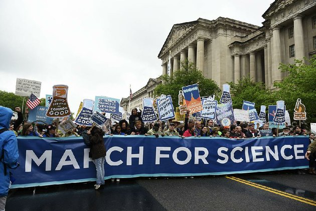 a-march-for-science-crowd-passes-the-environmental-protection-agency-offices-saturday-in-washington-in-one-of-many-earth-day-events-around-the-world-in-support-of-science-scientists-and-scientific-facts
