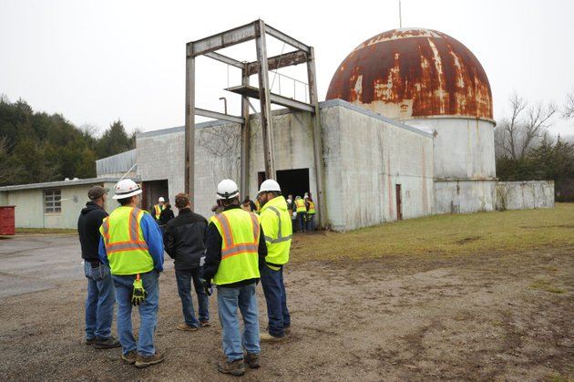 visitors-and-officials-from-the-university-of-arkansas-and-energy-solutions-speak-jan-19-during-a-tour-of-the-shuttered-sefor-nuclear-facility-near-strickler-in-southern-washington-county