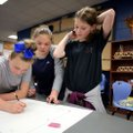 Kylee Dunn (from left), Emma Evans and Alyssa Wilson, all sixth-graders at Sonora Middle School, wor...