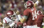 Arkansas defensive lineman Armon Watts (86) rushes Alabama quarterback Jake Coker (14) during the second quarter on Saturday, Oct. 10, 2015, at Bryant-Denny Stadium in Tuscaloosa, Ala.