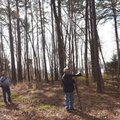 Joe Neal (from left), David Oakley and Terry Stanfill explore a pine grove at the nursery pond. The ...