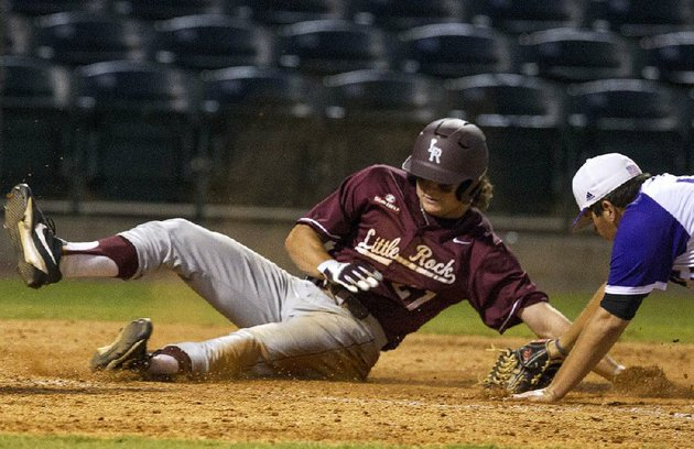 ualr-baserunner-riley-pittman-slides-across-home-plate-past-uca-pitcher-will-brand-to-score-in-tuesday-nights-game-at-dickey-stephens-park-in-north-little-rock-the-trojans-beat-the-bears-11-6-to-avenge-a-12-3-loss-to-their-in-state-rivals-on-march-14