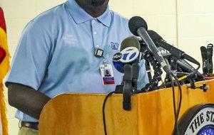 Prison spokesman Solomon Graves is shown speaking to the media in this photo.