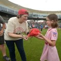 "Megan Cavanagh, who played Marla Hooch in ""A League of Their Own,"" autographs a hat at last year's r..."