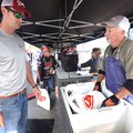 Steve Sizemore (right), formerly of Rogers who now works for FLW Outdoors in Benton, Ky., helps angl...