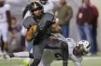 Charleston receiver Sean Michael Flanagan breaks away from Prescott defender Ja'mozyia Williamson (right) during the second half Saturday, Dec. 10, 2016, at War Memorial Stadium in Little Rock. Flanagan finished with 11 catches for 130 yards and 3 rushes for 51 yards and 1 touchdown in the Class 3A championship game.