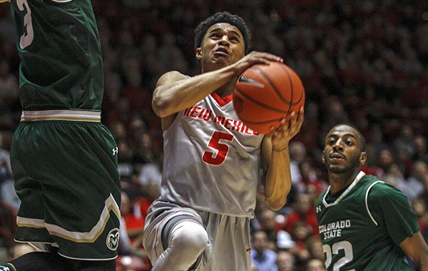 New Mexico's Jalen Harris (5) drives between Colorado State's J.D. Paige (22) and Gian Clavell during the first half of an NCAA college basketball game in Albuquerque, N.M., Tuesday, Feb. 21, 2017. (AP Photo/Juan Antonio Labreche)