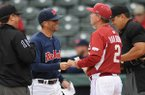 Arkansas coach Dave Van Horn, right, talks with Ole Miss coach Mike Bianco prior to a game Saturday, April 28, 2017, in Fayetteville.