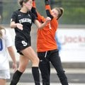 Emma Welch (9) of Bentonville High tries to head the ball into the goal as Rogers High goalkeeper Ma...
