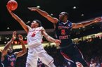 Fresno State forward Karachi Edo (4) and guard Jahmel Taylor contest a drive to the basket by New Mexico guard Jalen Harris in the second half of the Lobos' 78-73 victory.  JUAN ANTONIO LABRECHE Associated Press