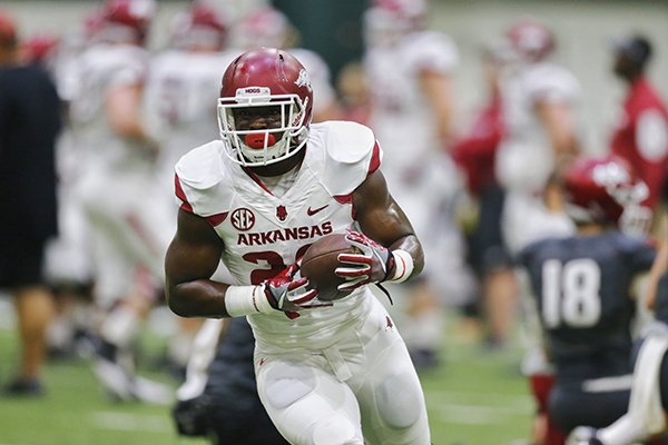 Arkansas running back Rawleigh Williams goes through practice Saturday, April 29, 2017, in Fayetteville.