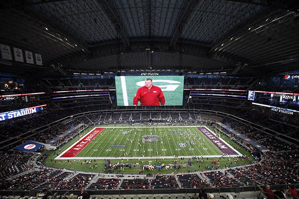 Arkansas head coach Bret Bielema is shown on the large video screen as teams warm up before an NCAA college football game against Texas A&M at AT&T Stadium on Saturday, Sept. 24, 2016, in Arlington, Texas. (AP Photo/Roger Steinman)