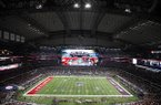 The large video screen shows the Arkansas and Texas A&M logos before an NCAA college football game at AT&T Stadium on Saturday, Sept. 24, 2016, in Arlington, Texas. (AP Photo/Roger Steinman)