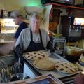 Cathie Brown removes pies Friday from the oven at the Oark Grocery and Cafe, where she works. Brown ...