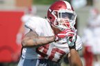 Arkansas linebacker Kyrei Fisher takes part in a drill Saturday, April 1, 2017, during practice at the university practice field in Fayetteville.