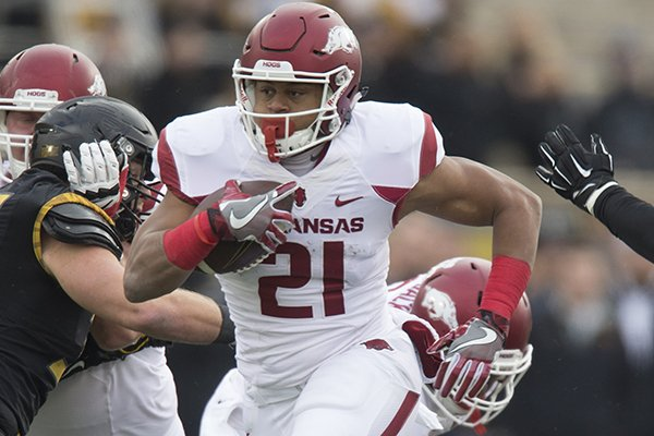Arkansas running back Devwah Whaley carries the ball during a game against Missouri on Friday, Nov. 25, 2016, in Columbia, Mo.