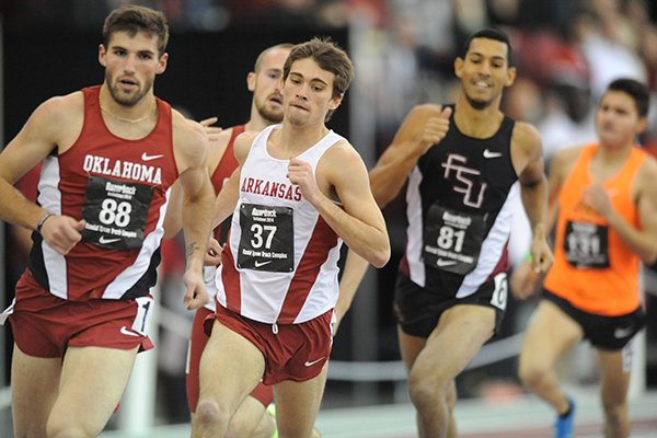 Arkansas' Cale Wallace (37) competes in the mile invitational during the Razorback Invitational Saturday, Feb. 1, 2014, at the Randal Tyson Track Center in Fayetteville.