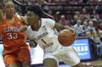 Florida State's A'Tyanna Gaulden drives the lane as Clemson's Alexis Carter defends in the fourth quarter of an NCAA college basketball game, Saturday, Feb. 18, 2017, in Tallahassee, Fla. Florida State won 80-47. (AP Photo/Steve Cannon)