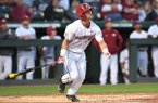 Arkansas outfielder Dominic Fletcher watches a hit during a game against LSU on Friday, April 7, 2017, in Fayetteville.