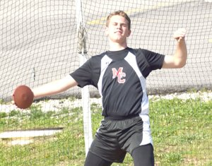 Photo by Rick Peck McDonald County seventh-grader Garrett Gricks lets loose the discus on his way to taking second in the event with a throw of 97-10. Gricks added a first place in the shot put (40-0) and a sixth in the 200 (28.2) to lead his team to a third place finish in the Big 8 Conference Junior High Track and Field Championships held May 2 at MCHS.