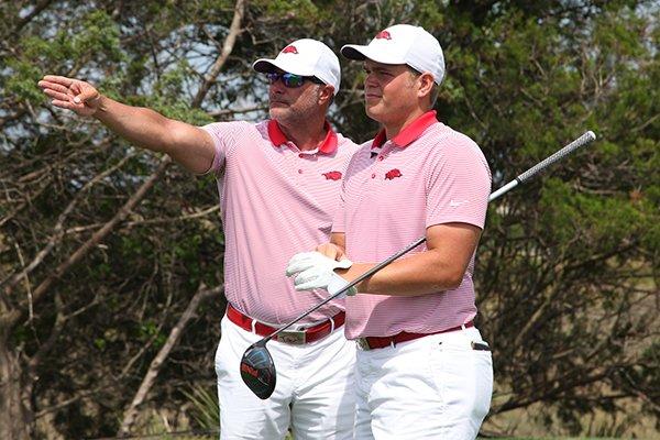Arkansas' Mason Overstreet, right, talks with coach Brad McMakin during the SEC Championship at Sea Island Golf Club in St. Simons Island, Ga.
