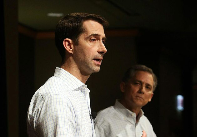 senator-tom-cotton-left-with-congressman-french-hill-right-looking-on-answers-a-question-at-a-joint-town-hall-meeting-at-the-embassy-suites-hotel-in-west-little-rock-april-17-2017