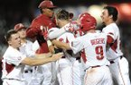 Arkansas players mob Luke Bonfield (17) after Bonfield's game-winning single in the ninth inning of a game against Vanderbilt on Friday, May 12, 2017, in Fayetteville.