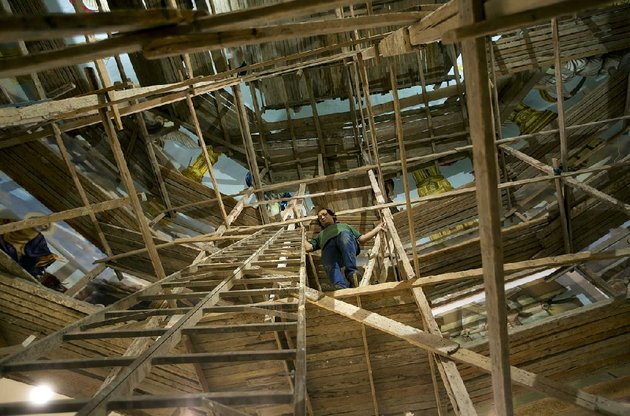 climbing-scaffolding-artist-ayman-william-moves-from-mural-to-mural-within-mar-girgis-church-in-cairo-which-is-building-a-new-extension