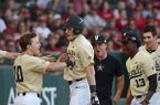 Ethan Paul (10), Vanderbilt second baseman, congratulates Will Toffey (9), Vanderbilt third baseman, after Toffey hit a home run Saturday, May 13, 2017, during the fifth inning against Arkansas at Baum Stadium in Fayetteville.