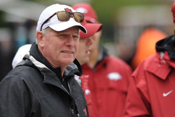 Arkansas coach Chris Bucknam watches Saturday, April 22, 2017, during the John McDonnell Invitational at John McDonnell Field in Fayetteville.