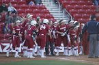 Arkansas players celebrate during a game against Nebraska on Friday, March 3, 2017, at Bogle Park in Fayetteville.