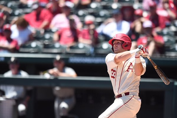 Arkansas catcher Grant Koch hits a home run during the first inning of a game against Vanderbilt on Sunday, May 14, 2017, in Fayetteville.