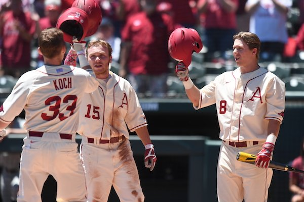 Jake Arledge (15) and Eric Cole (8) congratulate Grant Koch after Koch hit a home run in Arkansas' 7-1 win over Vanderbilt on Sunday May 14, 2017 at Baum Stadium in Fayetteville.