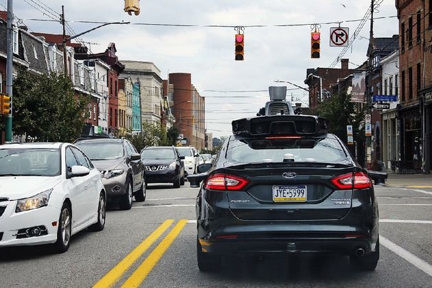 a-self-driving-uber-car-stops-at-a-red-light-on-liberty-avenue-through-the-bloomfield-neighborhood-of-pittsburgh-in-september