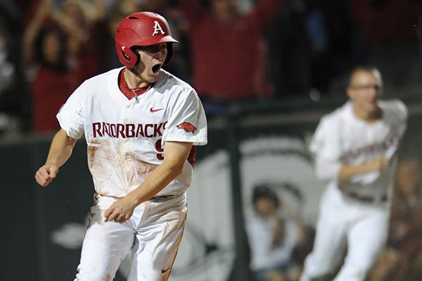 Arkansas shortstop Jax Biggers reacts after scoring the game-winning run against Vanderbilt during the ninth inning Friday, May 12, 2017, in Fayetteville.
