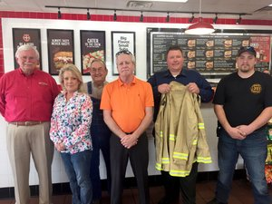 Submitted Photo The city of Gravette Fire Department received 20 sets of turnout gear valued at $9,717 at an awards ceremony Tuesday, May 2, at the Firehouse Subs restaurant in Bentonville. The grant award was funded through the Firehouse Subs Public Safety Foundation. Attending the awards presentation were Jim Maxwell (left), Firehouse Subs area representative; Tracy Bush, Firehouse Subs franchisee; Rod Clardy, Gravete city councilman; Carl Rabey, Gravette finance director; Lieutenant Dave Winter (holding coat), Gravette Fire Department; and Lieutenant Josh Blocker, Gravette Fire Department.