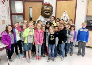 "Photo submitted Ms. George's first-grade class collected the most food of any first-grade classroom at Allen Elementary School for Arvest Bank Siloam Springs' recent ""Strike Out Hunger"" food drive. They were rewarded with a pizza party and a visit from the Northwest Arkansas Natural's mascot Strike."
