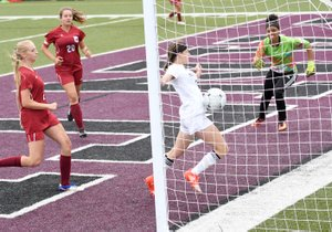 Bud Sullins/Special to the Herald-Leader Siloam Springs sophomore Hadley Crenshaw uses her body to score a second-half goal against Texarkana on Friday in the Class 6A quarterfinals at Panther Stadium.