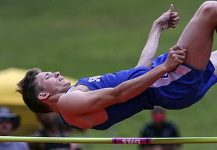 Arkansas Democrat-Gazette/Mitchell Pe Masilun MULTI-TASKING ATHLETES: Sheridan's Michael Burnett competes in the high jump during the Arkansas high school decathlon Wednesday at Cabot High School. Gosnell's Marquel McKinney led after the first five events while Clinton's Annie Hensley led after four events of the high school heptathlon, both events ending today.