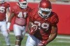 Arkansas running back Juan Day (39) runs drills during practice Thursday, April 7, 2016, in Fayetteville.