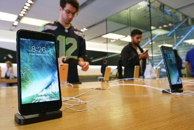 the-apple-iphone-7-is-displayed-at-the-apple-store-at-the-grove-in-los-angeles-in-september-qualcomm-inc-the-chip-company-is-suing-manufacturers-of-the-iphone