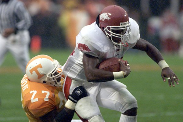 Arkansas running back Madre Hill (34) is tackled by Tennessee linebacker Al Wilson (27) during a game Saturday, Nov. 14, 1998, in Knoxville, Tenn.