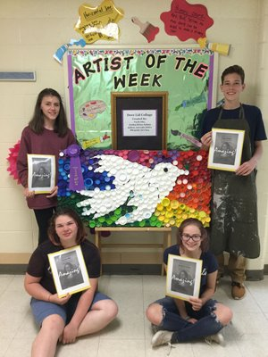 "SWC school and Ms. Smith are very proud to present the Artists of The Week! These eighth-grade students also won Best of Show at the recent Fine arts night in SWC for this ""Dove Lid Collage"" pictured. Seated (left to right): Fayth Olin, Jordan Heins. Standing (left to right): Sydney Killion, Luke Kitlen"