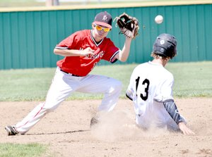 Photo by Rick Peck Neosho's Marcus Crawford steals second base as McDonald County's Jordan Platter tries to snag a throw from catcher Emanuel Baisch during the Wildcats 7-1 win in the opening round of the district baseball tournament at Webb City High School.