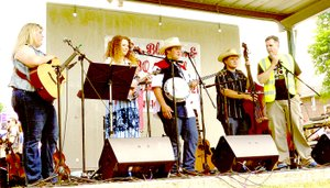 File photo Ken Schutten of the Anderson Betterment Club introduced the Ozark Wildfire Band at the Anderson Berries, Bluegrass & BBQ Festival last year.